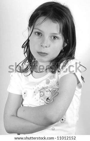 Pretty Young Girl Portrait Shot against a Light Background - stock photo
