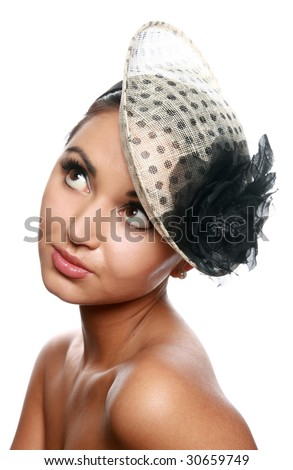 Pretty young girl portrait with a vintage hat isolated on white - stock photo