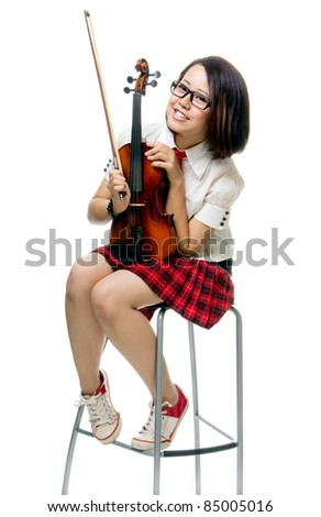 pretty young girl poses with violin, isolated white background