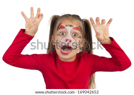 Pretty young girl posing with the cat face makeup - stock photo