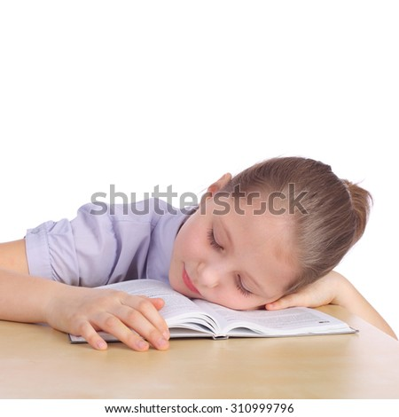 pretty young girl sleeping on the opened book - stock photo