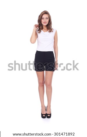 pretty young girl wearing black shorts - stock photo