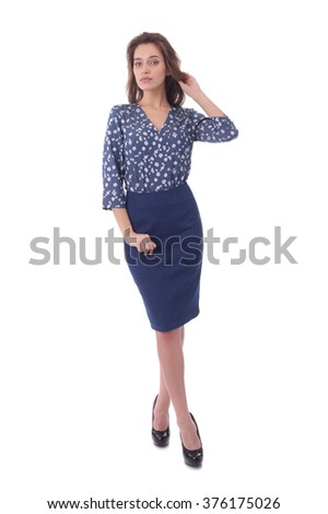 pretty young girl wearing blue formal skirt and flower print blouse - stock photo