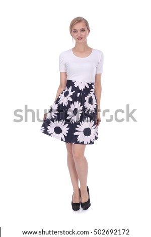 pretty young girl wearing floral printed skirt and white t-shirt