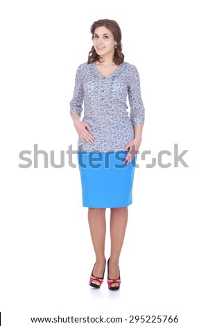 pretty young girl wearing flower printed blouse and blue skirt - stock photo