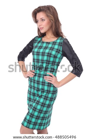 pretty young girl wearing green chequered dress and high boots
