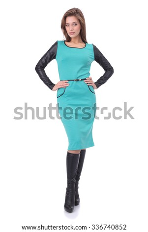 pretty young girl wearing green dress with the high boots - stock photo