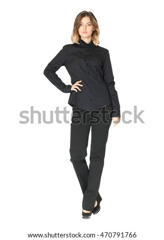 Pretty young girl wearing long black trousers