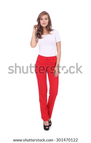 pretty young girl wearing long red trousers - stock photo
