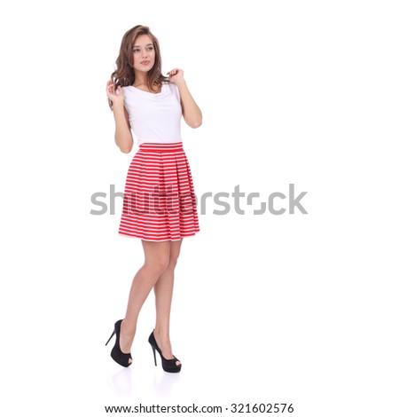 pretty young girl wearing red short striped skirt