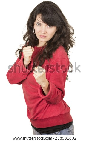 pretty young girl wearing red top posing with fists gesturing fight isolated on white - stock photo