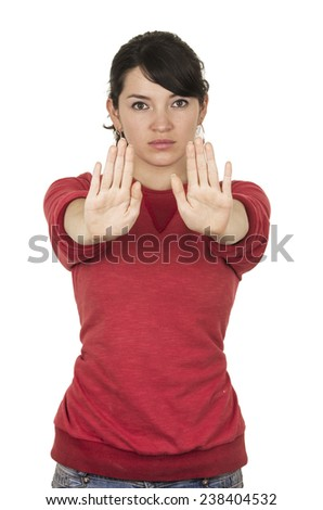 pretty young girl wearing red top posing with hands gesturing stop isolated on white - stock photo