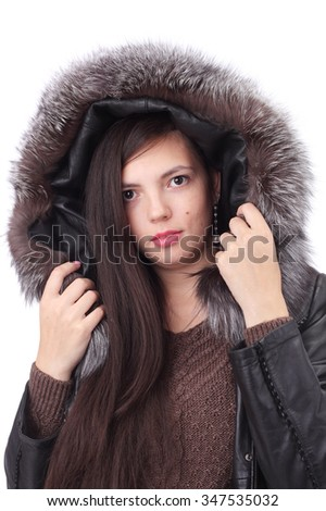 pretty young girl wearing winter clothing