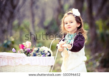 Pretty young girl with spring flowers - stock photo