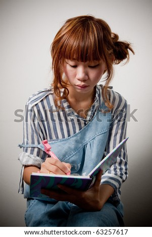 pretty young girl writing.