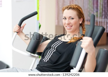 Pretty young happy smiling woman going fitness exercising