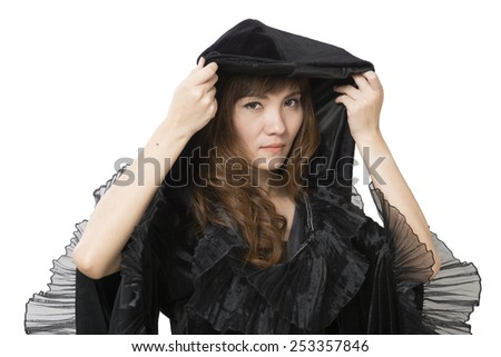 pretty young happy woman smiling and dressed as a fairy or witch - stock photo