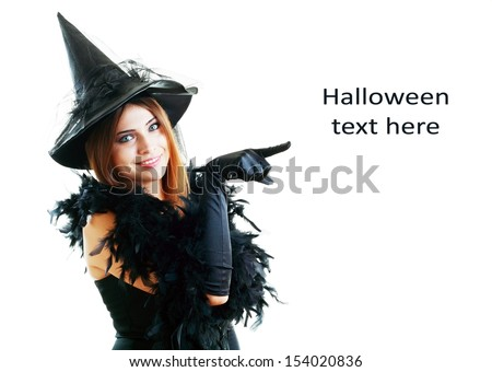 pretty young happy woman smiling and dressed as a fairy or witch for halloween party show point finger to copyspace - stock photo