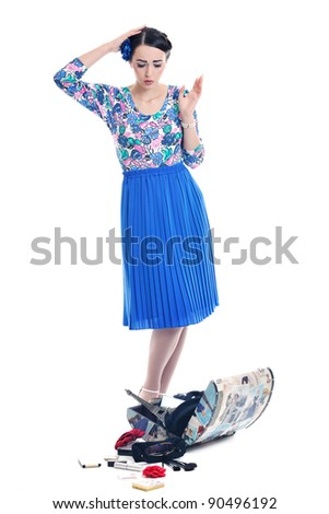 pretty young happy woman with travel bag waiting and posing isolated on white backround  in studio