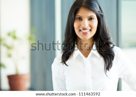 pretty young indian white collar worker in office - stock photo