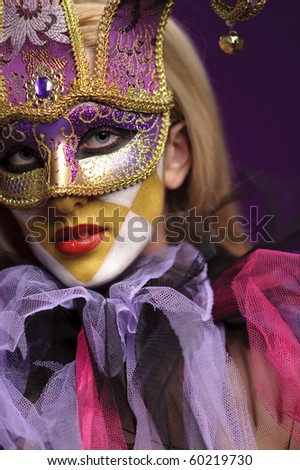 pretty young lady in violet half mask, may be use for joker concept