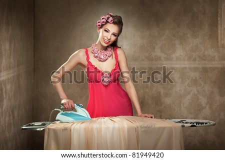 Pretty young lady ironing
