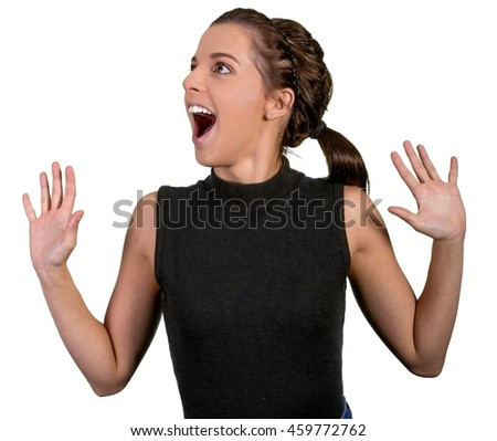 Pretty young lady with excited expression and hands out stretched