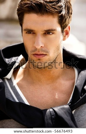 Pretty young man posing , outside shot - stock photo