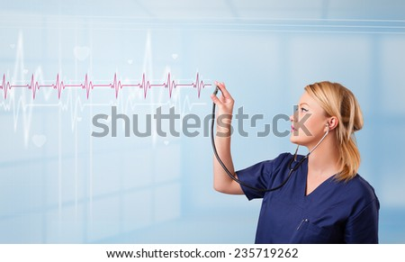 Pretty young medical doktor listening to red pulse and heart rates - stock photo