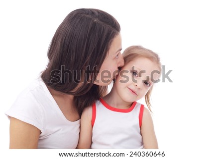 pretty young mother embracing her cute little daughter