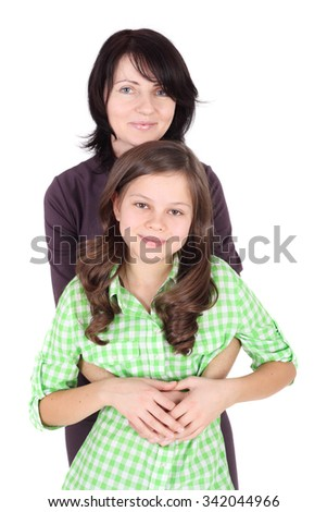 pretty young mother embracing her little daughter - stock photo