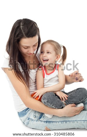 pretty young mother with her cute little daughter - stock photo