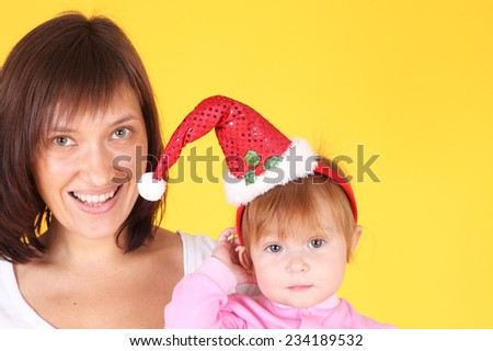 pretty young mother with her little baby - stock photo