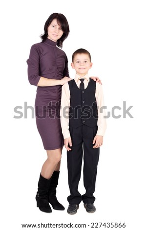 pretty young mother with her pupil son - stock photo