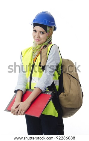 Pretty young Muslim woman as practical student in industrial training mode. - stock photo