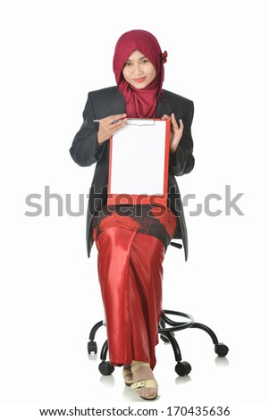 pretty young Muslim woman pose with holding a blank paper