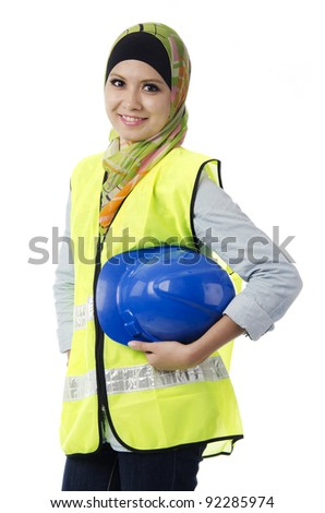 Pretty young Muslim woman with safety suit posses in action. - stock photo