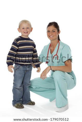 Pretty young nurse with young boy on white background