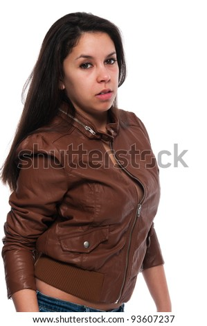 Pretty young petite Latina in a brown leather jacket