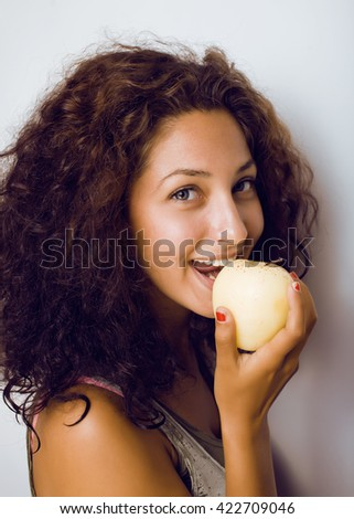 pretty young real tenage girl eating apple close up smiling - stock photo