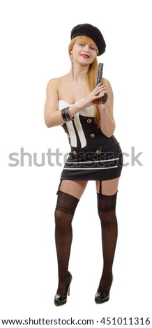 pretty young sexy woman with a gun on white background - stock photo