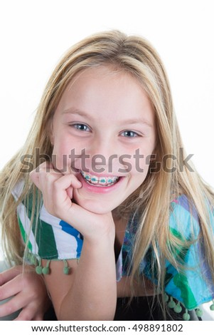 Pretty young smiling girl Isolated over white background