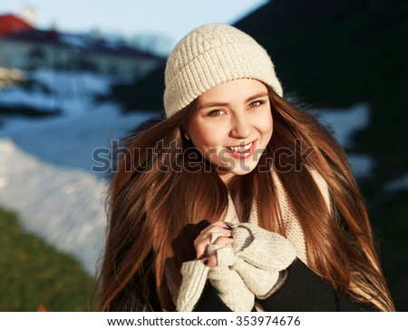 Pretty young smiling sensual woman outdoor winter portrait