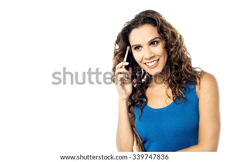 Pretty young smiling woman on call - stock photo