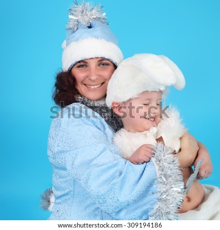 pretty young Snow Maiden with the cute little hare