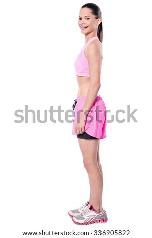 Pretty young sporty lady, full length portrait. - stock photo