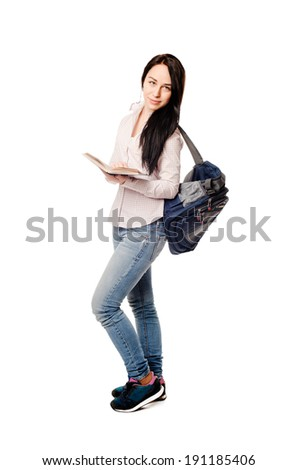 pretty young student girl studying with books on white background - stock photo
