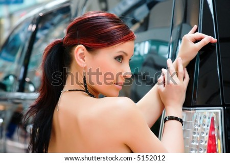 Pretty young woman and the car. - stock photo