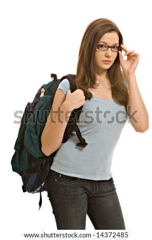 Pretty young woman carrying backpack - stock photo