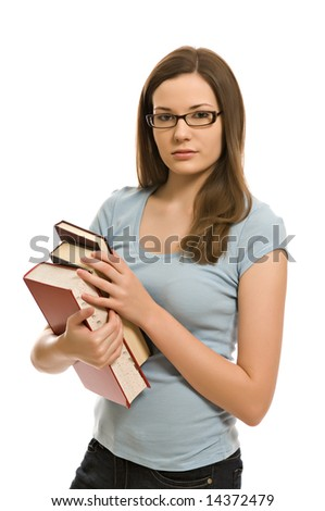 Pretty young woman carrying books - stock photo